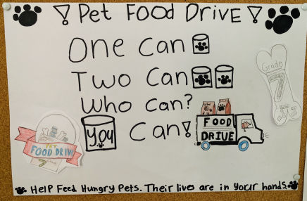 A poster advertising the pet food drive