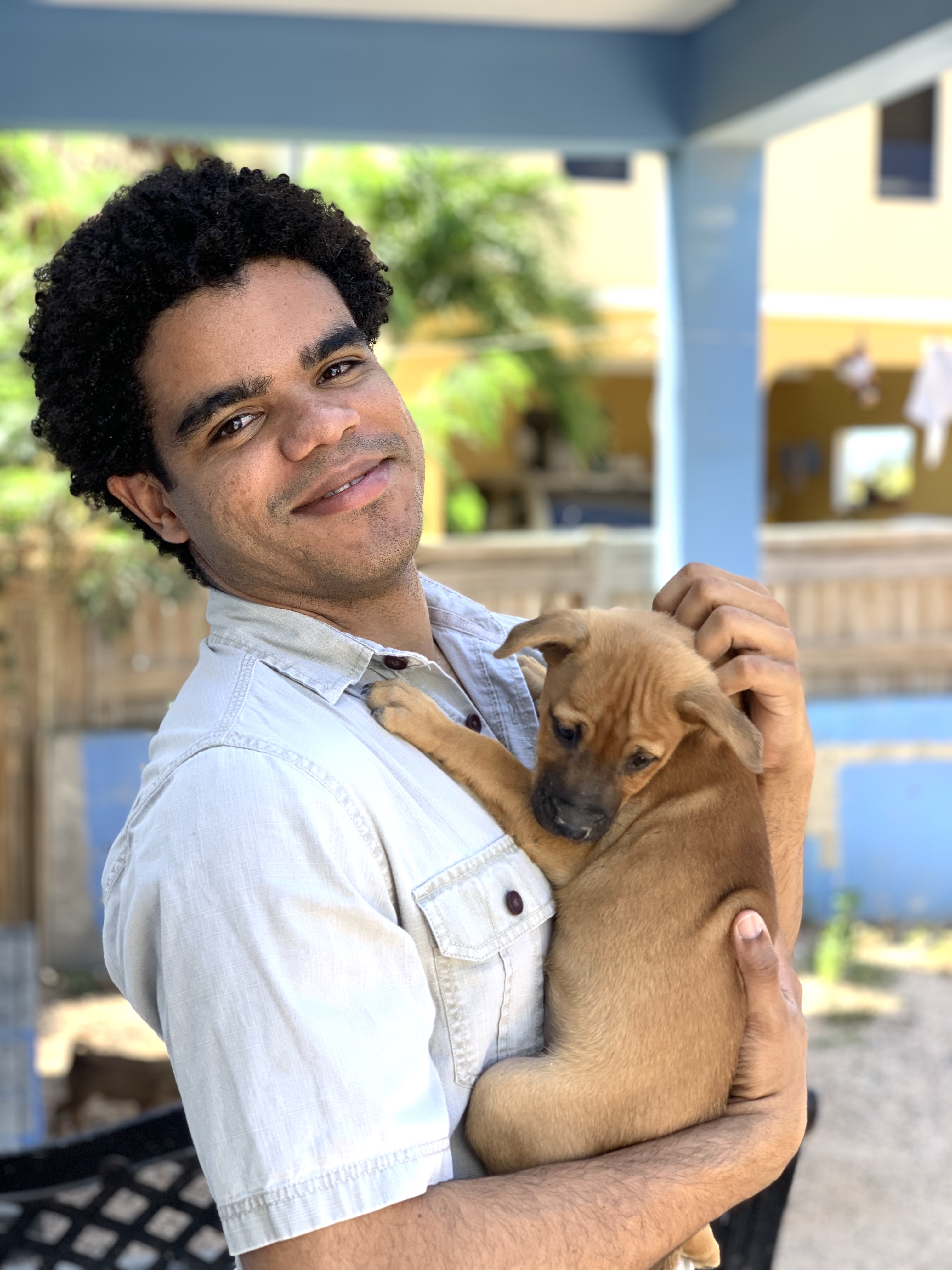 A man takes home a brown puppy from AARF