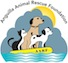 This is the AARF logo, which shows shows three animals on a yellow life raft: a small black and white kitten, a larger brown dog with a collar (a symbol of good animal care practice) and a small black and white dog. Grey clouds suggest an urgent need to find good homes for these animals. The raft (floating on blue waves representing the Caribbean sea surrounding Anguilla) shows that these animals have protectors in AARF and its many supporters. Finally, the sun peeks out from behind the clouds, signifying hope for these deserving animals.